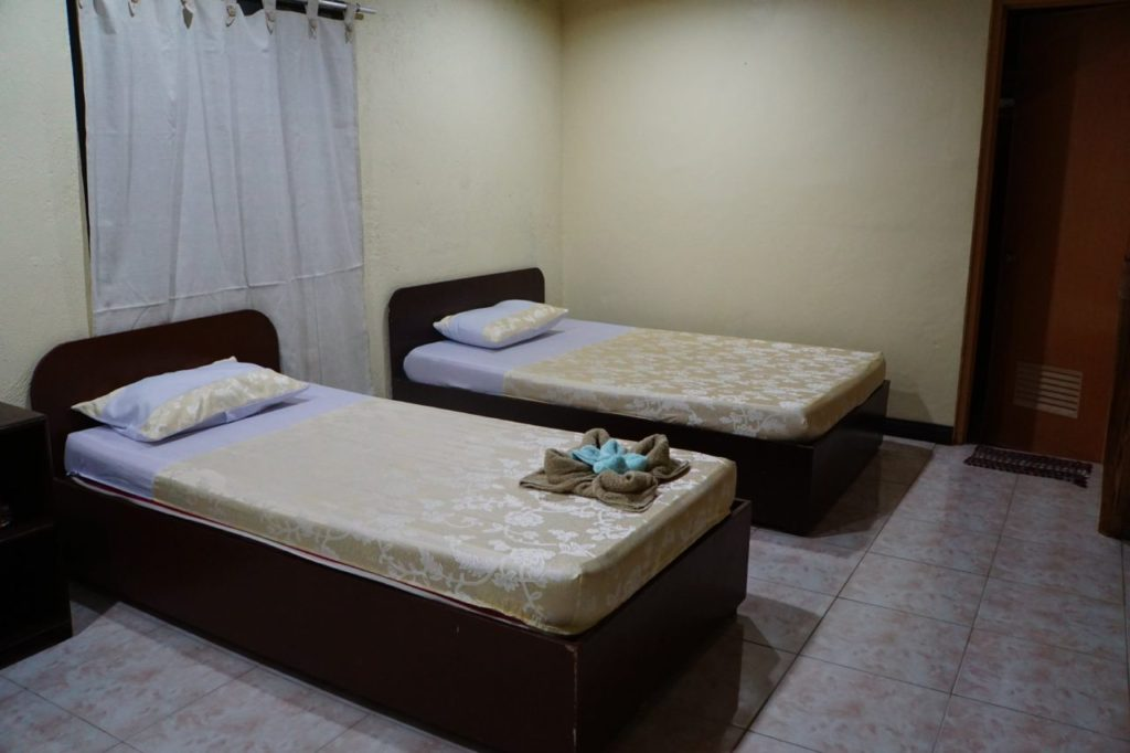 ノバビーチデラックスルームのベッド